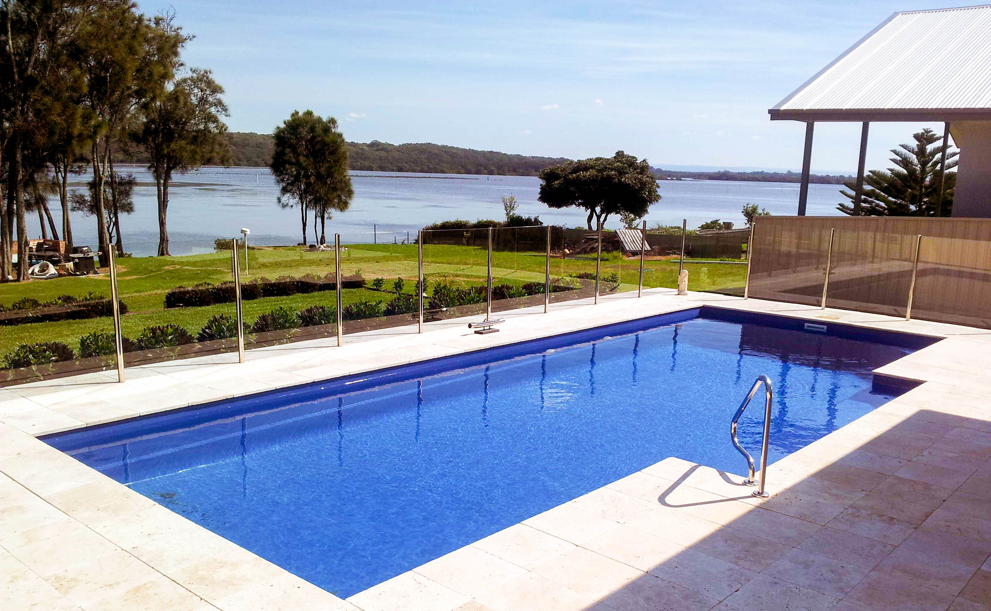Contemporary blue water pool view