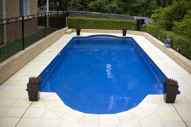 Swimming pool Caesar Design surrounded by green bush
